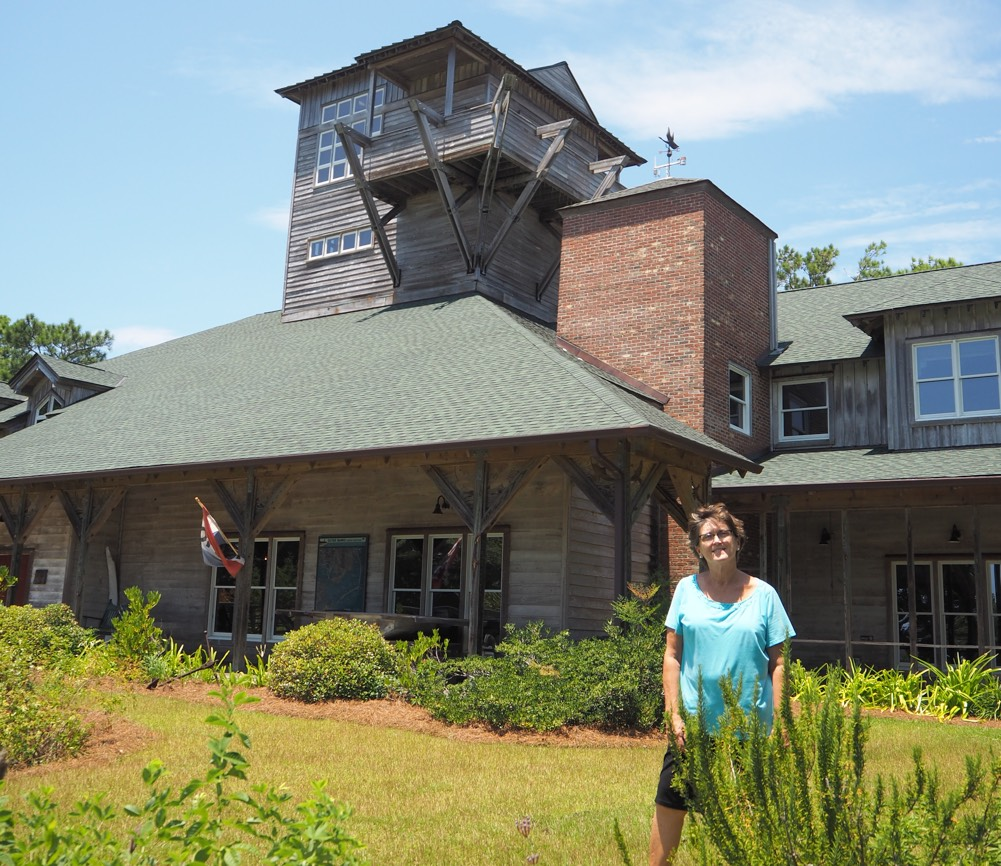 Karen stands in front of the Core Sound Waterfowl Museum